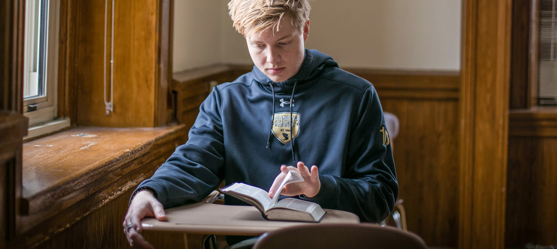 Photo of Geneva Student reflecting in prayer and Bible reading