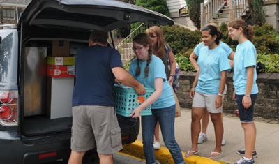 Student leaders help with new freshman move-in day.