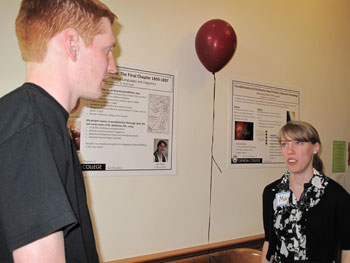 Senior honors students present their research.