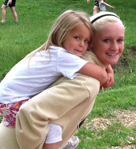 Softball players bonded quickly with the children during their community service time.