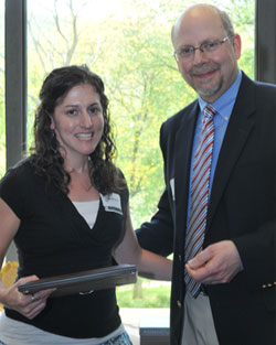Allyson Bentz receives her Exemplary Service Award from President Ken Smith.