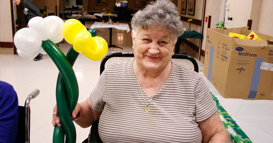 Enjoying balloon creations at Providence Care Center.